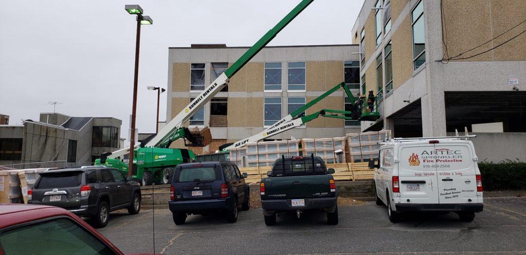 BWK crew working at 839 Merrimack Street, Lowell, MA